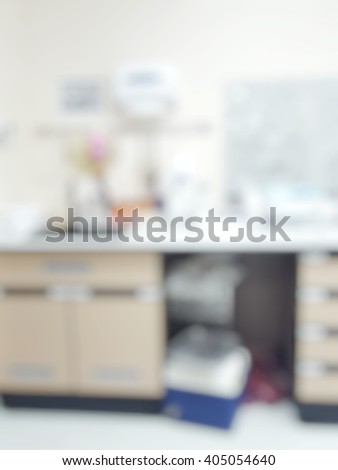 Blur abstract background white microbiology laboratory cleaning workstation office for research or education.Blurry view of empty modern white medical or chemical lab for safety at work. - stock photo