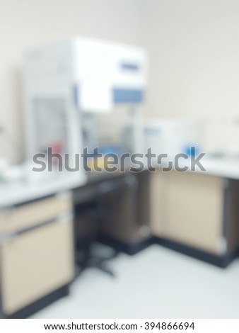 Blur abstract background  white microbiology laboratory workstation office with cabinet for research or education - stock photo