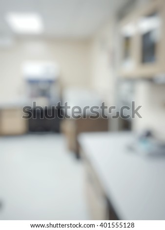 Blur abstract background white microbiology laboratory workstation office with cabinet for research or education.Blurry view of empty modern white medical or chemical lab - stock photo