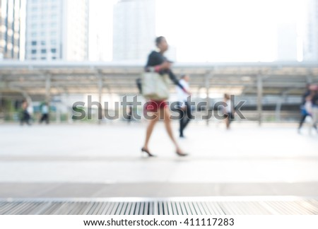 Blur abstract of businessman,people walking in the walking of city landmark.Light flare silhouettes motion style