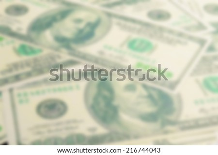 blur abstract of one hundred dollars pile as background.