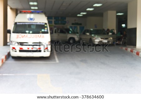 Blur ambulance car at hospital - stock photo