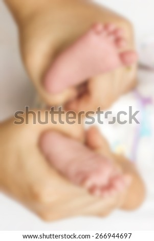 Blur Baby feet into mothers hands.