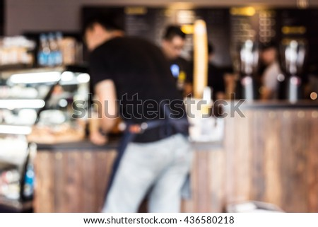 Blur back of waiter at coffee shop. - stock photo