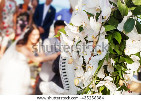 blur background bride and groom with happy groomsmen and bridesmaids having fun, luxury wedding at pool party - stock photo