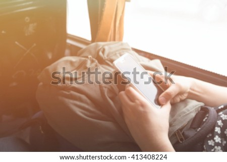blur background, Businesswoman Sending Text Message On Bus - stock photo