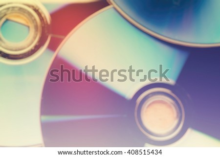 blur background, Close up view of a CD/DVD on wood table, vintag - stock photo