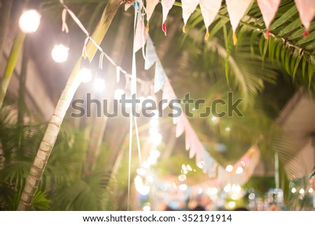 Blur background colorful triangular flags of decorated celebrate outdoor party. - stock photo