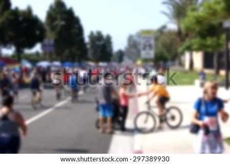 blur background crowd walking around at outdoor festival - stock photo