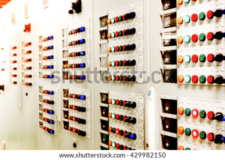Blur background electrical safety concept the electrical control panel background in electrical engineering room. - stock photo