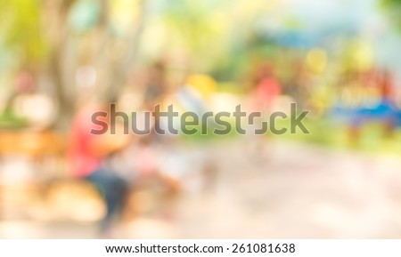Blur background image of people activities in public park with bokeh . - stock photo