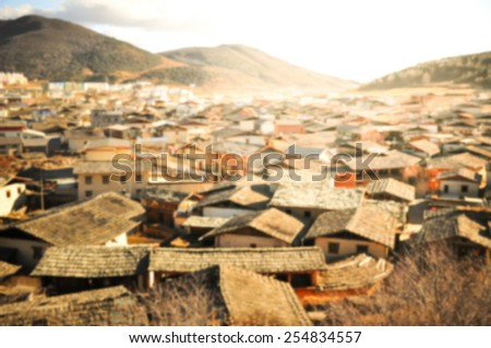 Blur background image of unique roof in Chinese town mountain View