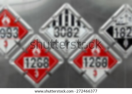 Blur Background Image - USDOT Hazardous Materials Transportation Placards on rear of a Fuel Tanker