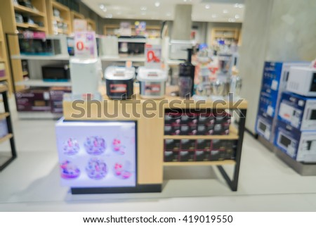 blur background of Electrical appliance stores background in the mall shopping,Mashie And Appliance Or Household Or Washer,Coffee machine, Watches In Shop.can use for background.vintage tone - stock photo