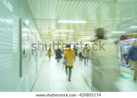 Blur background of passengers walking on the subway at rush hour - stock photo