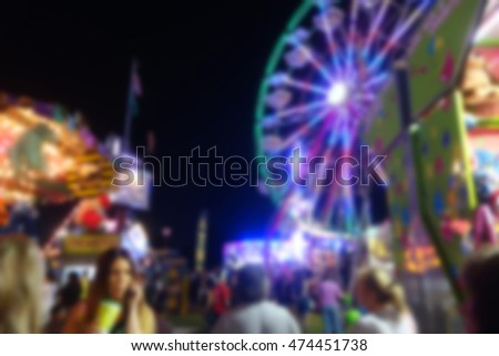 blur background of people at county fair at night
