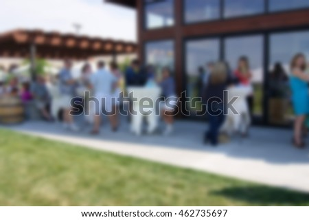 blur background of people at outdoor event