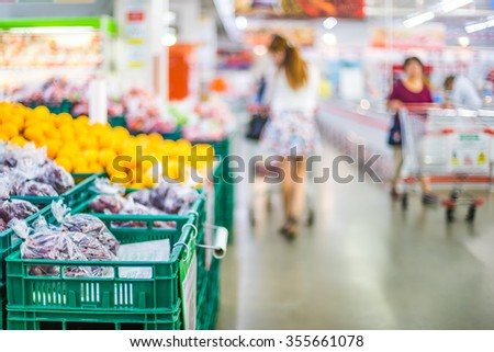 blur background of people shopping in supermarket - stock photo