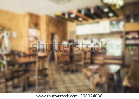 Blur background of restaurant or coffee shop vintage style.