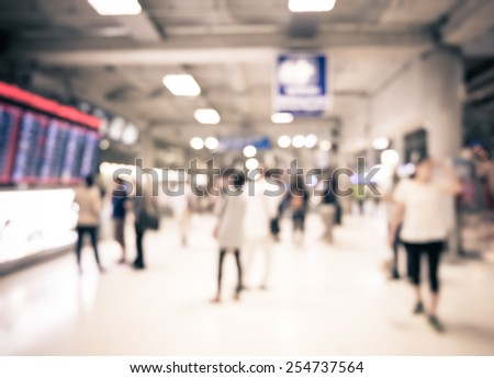 Blur background : People at departure and arrivals electronic schedule board in airport. - stock photo