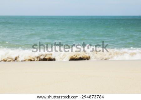Blur background photo of waves crashing onto shore  - stock photo