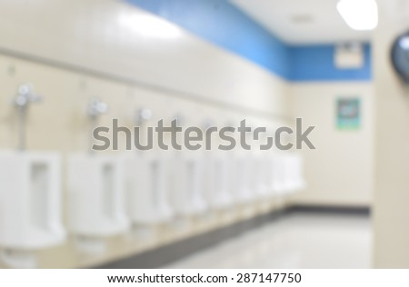 blur background public toilet men - stock photo