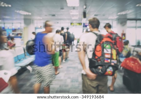 Blur background travelers boarding area at airport - stock photo