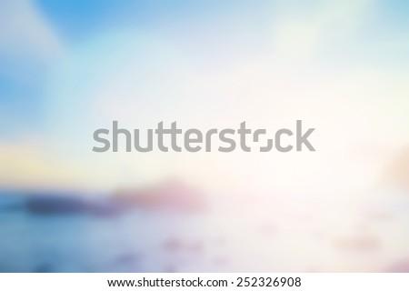 Blur beach. Vintage Style Break Relax View Sun Ocean Wave Sea Sand Surf Dream Rest Enjoy Earth Fresh Resort Travel Calm Cloud Aqua Park idyllic White Ray Bath Bokeh Abstract concept Flare Blurry Glow - stock photo