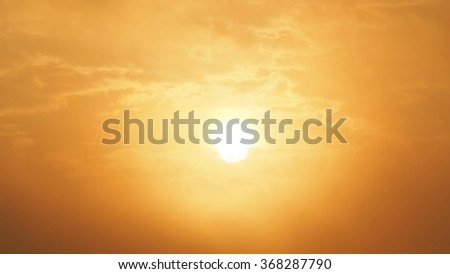 Blur beautiful sun and orange sky. Sunset sunrise in background. Abstract orange sky. Dramatic golden sky at the sunset background. - stock photo