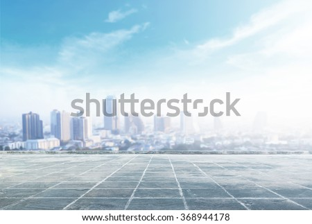 Blur big city at rooftop of hotel. Aerial Amazing Light Bangkok Thailand Asia Dinner Date Tower Town Food Capital History Bar Sun Enjoy Luxury Drink Relax High Loggia Couple Love Border Happy concept. - stock photo