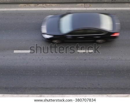 Blur black car on the road from top view