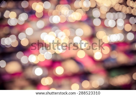 Blur bokeh background of multicolour lights of free market at night , vintage tone - stock photo