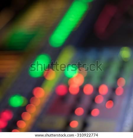 Blur bokeh light from digital audio mixer  - stock photo
