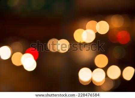 Blur bokeh traffic light in urban at night background - stock photo