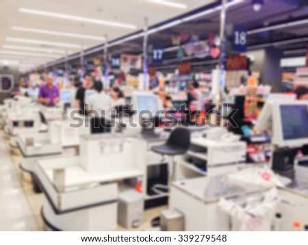 Blur cashier counter in the supermarket - stock photo
