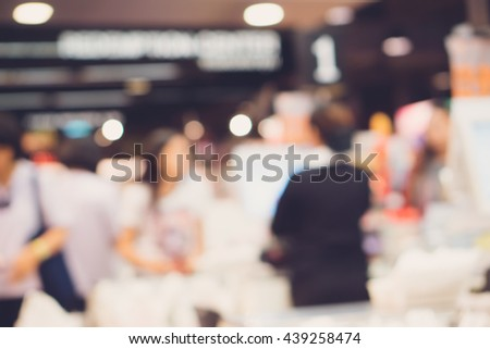 Blur cashier counter in the supermarket,Cashier at a supermarket checkout in a department store.Vintage tone.  - stock photo