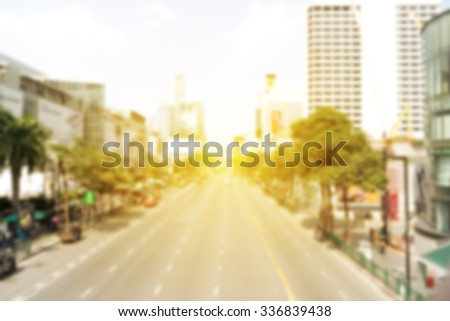 blur city background with light flare  - stock photo