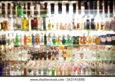 Blur colorful alcohol drink bottles for background