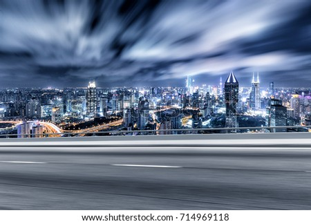 blur emtpy asphalt road and cityscape of shanghai in blue cloud sky at twilight