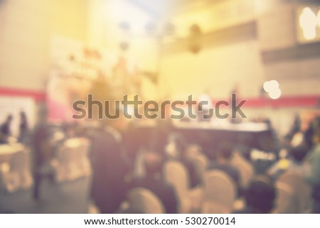 blur event seminar with activity on stage - blurred background -  bokeh light vintage tone. business concept.