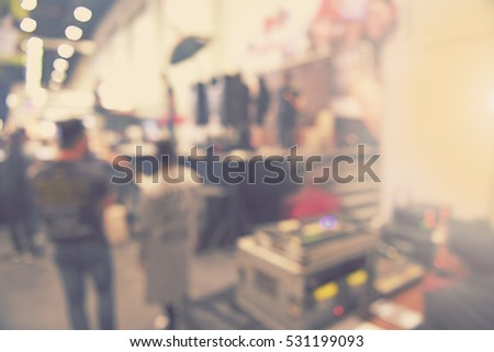 blur event seminar with activity on stage - blurred light and sound control background -  bokeh lighting vintage tone - business concept