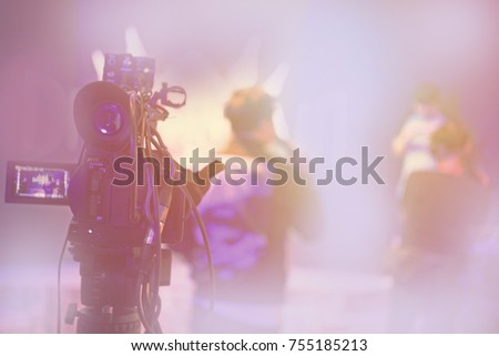 blur event with people background - blurred computer game show festival bokeh light vintage tone - people and activity on stage - camera man - business concept