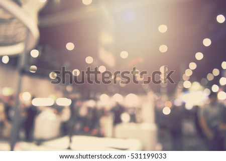 blur event with people background -  blurred electronic technology photo fair bokeh light vintage tone - business concept