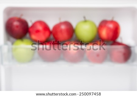 blur focus Fresh and clean apples on the refrigerator shelf. good to eat in diet. - stock photo