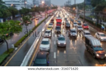 Blur focus of traffic jam with rain in Thailand. - stock photo