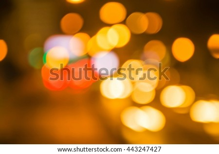 blur from the lights of cars on the road at night