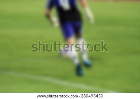blur goalkeeper knocks and kick the ball for background - stock photo