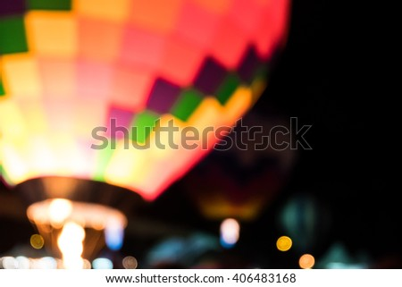 Blur hot air multicolor balloon on night time - stock photo