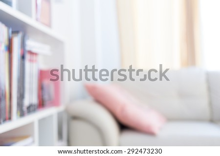 blur image background, book shelf and sofa furniture interior decoration in home - stock photo