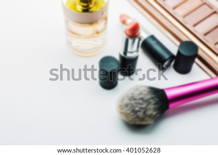 blur image background of makeup brush and cosmetics, on a white background